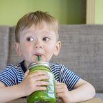 boy drinking green juice